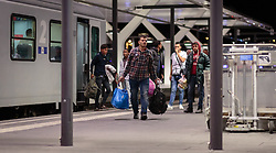 12.09.2015, Hauptbahnhof Salzburg, AUT, Fluechtlinge am Hauptbahnhof Salzburg auf ihrer Reise nach Deutschland, im Bild Migranten verlassen den Bahnsteig mit Gepäck // Migrants leave the platform with luggage. According to reports thousands of refugees fleeing violence and persecution in their own countries continue to make their way toward the EU, just days before Euopean leaders are set to meet in Brussels to discuss a solution to the arrival of so many people, Main Train Station, Salzburg, Austria on 2015/09/12. EXPA Pictures © 2015, PhotoCredit: EXPA/ JFK
