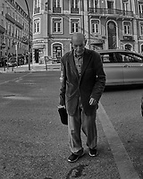 Old Man Crossing the Street. Street Photography in Lisbon. Image taken with a Nikon D850 camera and 8-15 mm fisheye lens.