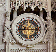 Astrological clock, 1525-28, by Jehan Texier or Jean de Beauce, telling the time, the day of the week, the month of the year, the time of sunrise and sunset, the phase of the moon and the current sign of the zodiac, on the chancel screen of Chartres Cathedral, Eure-et-Loir, France. Its inner workings were partially destroyed in 1793 during the French Revolution, and the face and mechanisms have been restored 2006-2010. Chartres cathedral was built 1194-1250 and is a fine example of Gothic architecture. It was declared a UNESCO World Heritage Site in 1979. Picture by Manuel Cohen.