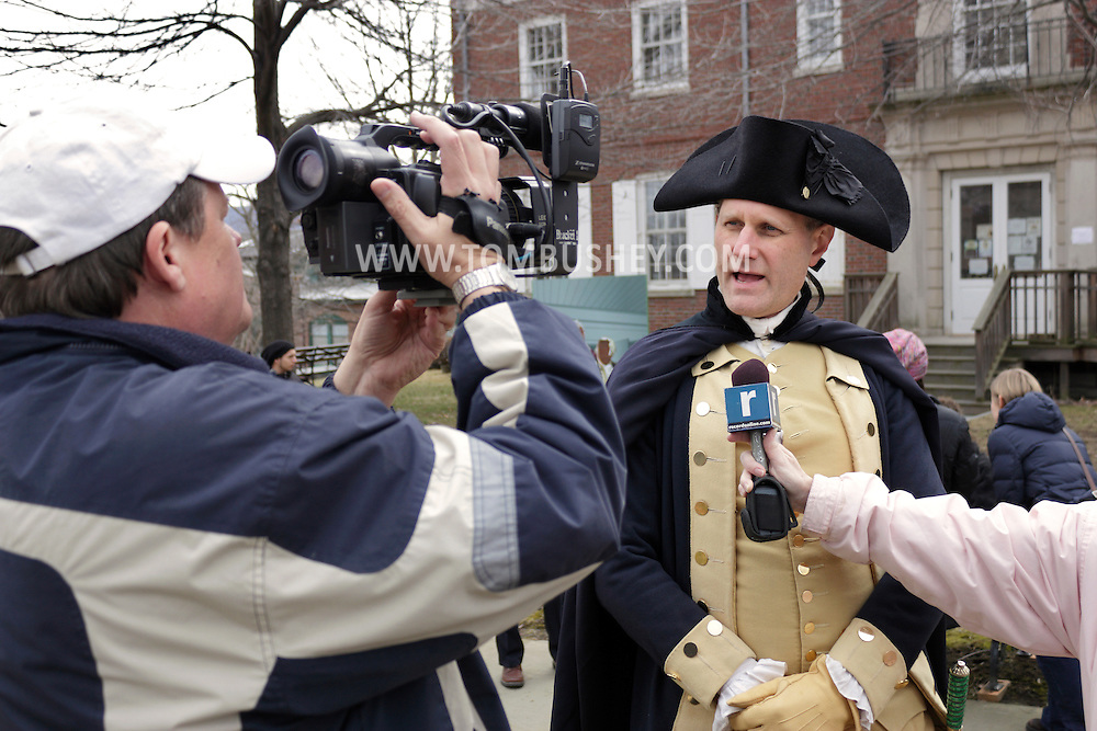 Newburgh, New York  - A Revolutionary War reenactor playing George Washington is interviewed by a videographer at Washington's Headquarters State Historic Site  as part of George Washington's birthday celebration on Feb. 18, 2012.