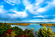 A double rainbow fills the sky over Lake James in the Blue Ridge Mountain range of the Pisgah National Forest in Morganton, North Carolina. Table Rock, Shortoff and Hawksbill Mountains fill the background scenery. <br />