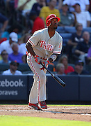 ATLANTA, GA - SEPTEMBER 01:  Shortstop Jimmy Rollins #11 of the Philadelphia Phillies follows the ball before it hit the foul pole for a home run during the game against the Atlanta Braves at Turner Field on September 1, 2012 in Atlanta, Georgia.  (Photo by Mike Zarrilli/Getty Images)