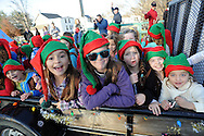 Members of Newtown Elementary Girls Scout troop ride on a float during the Newtown Holiday Parade Sunday December 6, 2015 in Newtown, Pennsylvania. (Photo by William Thomas Cain)