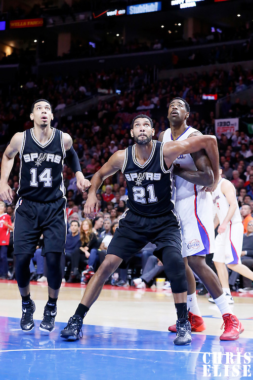 10 November 2014: San Antonio Spurs forward Tim Duncan (21) vies for the rebound with Los Angeles Clippers center DeAndre Jordan (6) next to San Antonio Spurs guard Danny Green (14) during the San Antonio Spurs 89-85 victory over the Los Angeles Clippers, at the Staples Center, Los Angeles, California, USA.
