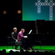 """March 9, 2013 - New York, NY : Pianist Anthony De Mare, with Daniel Sherman turning pages, performs  """"Liaisons II: Re-Imagining Sondheim From the Piano,"""" a series of Stephen Sondheim-inspired piano works at Symphony Space in Manhattan on Saturday night. CREDIT: Karsten Moran for The New York Times"""