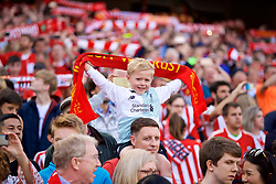 DUBLIN, REPUBLIC OF IRELAND - Saturday, August 5, 2017: A young Liverpool supporter holds up a scarf above his head before a preseason friendly match between Athletic Club Bilbao and Liverpool at the Aviva Stadium. (Pic by David Rawcliffe/Propaganda)