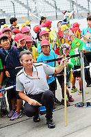 Sam Michael (AUS) McLaren Sporting Director with young fans in the pits.<br /> Japanese Grand Prix, Thursday 2nd October 2014. Suzuka, Japan.