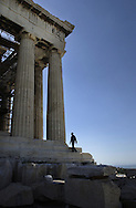A construction worker walks up the steps of the temple Athena Parthenos at the Acropolis in Athens, Greece on October 9, 2002. The temple, know as the Parthenon, was built from 447 BC to 432 BC by Pericles to honor Athens' patron goddess. .Photo by Jakub Mosur