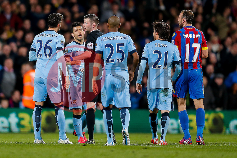 Sergio Aguero and Martin Demichelis of Manchester City appeal to referee Michael Oliver after Glenn Murray of Crystal Palace scores a goal to make it 1-0 - Photo mandatory by-line: Rogan Thomson/JMP - 07966 386802 - 06/04/2015 - SPORT - FOOTBALL - London, England - Selhurst Park - Crystal Palace v Manchester City - Barclays Premier League.