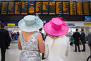 UNITED KINGDOM, London: 14 June 2016 Racegoers at Waterloo train station look at train times before heading to Royal Ascot for the first day of the annual horse racing event. Rick Findler / Story Picture Agency
