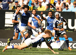 James O'Connor dives over the line for a try with Gio Aplon of the Stormers too late to stop the score during the Super Rugby (Super 15) fixture between DHL Stormers and the The Force played at DHL Newlands in Cape Town, South Africa on 26 March 2011. Photo by Jacques Rossouw/SPORTZPICS