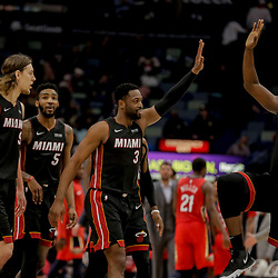 Dec 16, 2018; New Orleans, LA, USA; Miami Heat guard Dwyane Wade (3) celebrates with center Bam Adebayo (13) after a basket during the fourth quarter at the Smoothie King Center. Mandatory Credit: Derick E. Hingle-USA TODAY Sports