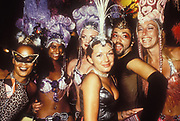 A bunch of cabaret girls wearing headgear and masks, Ibiza, 1998.