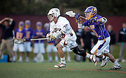 SHOT 5/11/13 6:28:20 PM - Denver's Chase Carraso #32 tries to outrace Albany's Ryan Feuerstein #20 during their first round NCAA Tournament lacrosse game at the Peter Barton Lacrosse Stadium on the University of Denver campus Saturday May 11, 2013. The University of Denver won the game 19-14 to advance. (Photo by Marc Piscotty / © 2013)