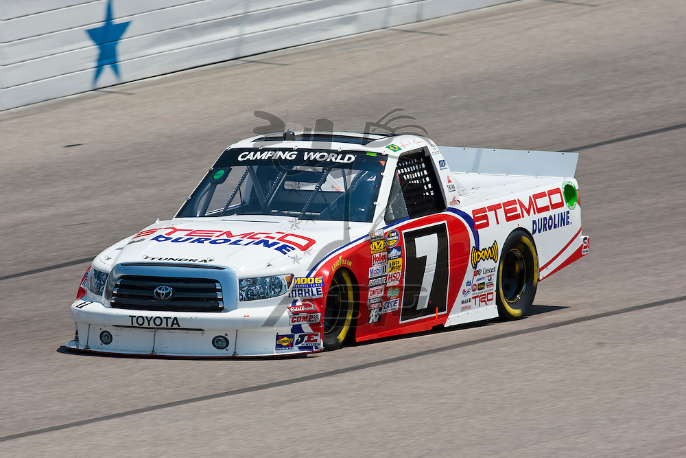 Fort Worth, TX - June 09, 2011:  Miqel Paludo (7) brings his Camping World Truck Series truck through the turns during a practice session for the WinStar World Casino 400 race in Fort Worth, TX.