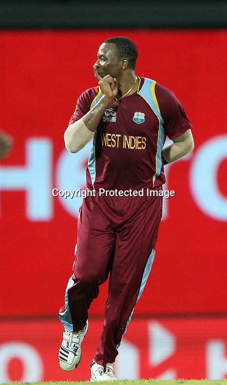 Kieron Pollard of The West Indies celebrates the wicket of Pat Cummins during the ICC World Twenty20 semi final match between Australia and The West Indies held at the Premadasa Stadium in Colombo, Sri Lanka on the 5th October 2012<br /> <br /> Photo by Ron Gaunt/SPORTZPICS