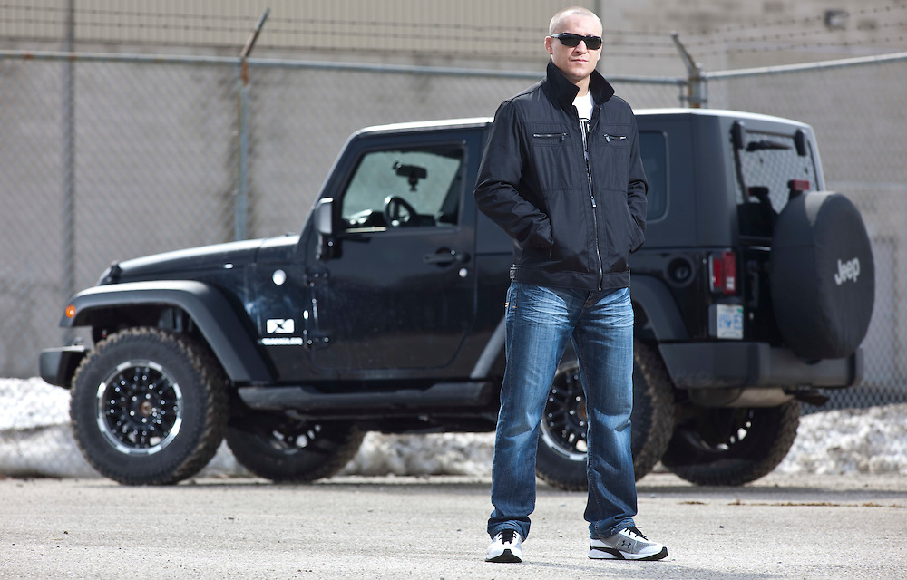London, Ontario ---11-03-18--- UFC fighter Mark Hominick stands with his his jeep wrangler outside of his training gym in London, Ontario, March 18, 2011.<br /> GEOFF ROBINS The Globe and Mail