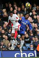 Photo: Lee Earle.<br /> Chelsea v Birmingham City. The Barclays Premiership.<br /> 31/12/2005.<br /> City's Julian Gray (L) battles with Didier Drogba in the air.