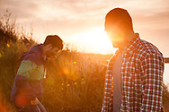 Men, Friendship, Talking, Sunset, Water's Edge, Lens Flare,
