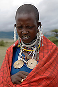 Masai woman in the forest the Ngorongoro Conservation Area or NCA is a conservation area situated 180 km west of Arusha in the Crater Highlands area of Tanzania.