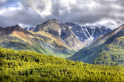Mountain range with rocky peak and and lots of trees