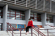 A refugee child, outside of the Temporary accommodation center for immigrants in Athens, at Olimpico hockey in the area Elliniko 10 Febraury 2016.<br />
