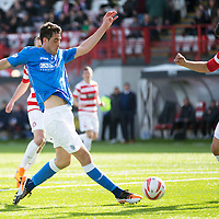 Hamilton Academical St Johnstone....04.04.15<br /> Brian Graham is closed down by Jesus Garcia Tena<br /> Picture by Graeme Hart.<br /> Copyright Perthshire Picture Agency<br /> Tel: 01738 623350  Mobile: 07990 594431