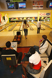 Teenage group at bowling alley.