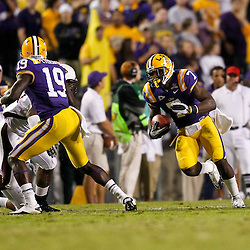 November 13, 2010; Baton Rouge, LA, USA; LSU Tigers cornerback Patrick Peterson (7) returns a punt during the second half against the Louisiana Monroe Warhawks at Tiger Stadium. LSU defeated Louisiana-Monroe 51-0.  Mandatory Credit: Derick E. Hingle