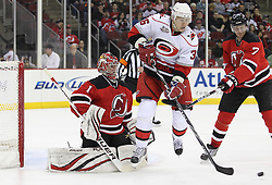 Feb 16; Newark, NJ, USA; Carolina Hurricanes left wing Jussi Jokinen (36) screens New Jersey Devils goalie Johan Hedberg (1) on a shot during the first period at the Prudential Center.