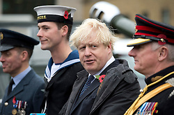 © London News Pictures. 05/11/2013 . London, UK.  Mayor of London BORIS JOHNSON, with members of the Armed Forces, after firing a gun salute to launch London Poppy Day at The Honourable Artillery Company in London. The Mayor fired a salute from a 105mm light gun to launch this year's campaign, which aims to raise more than £1million in just one day. Photo credit : Ben Cawthra/LNP