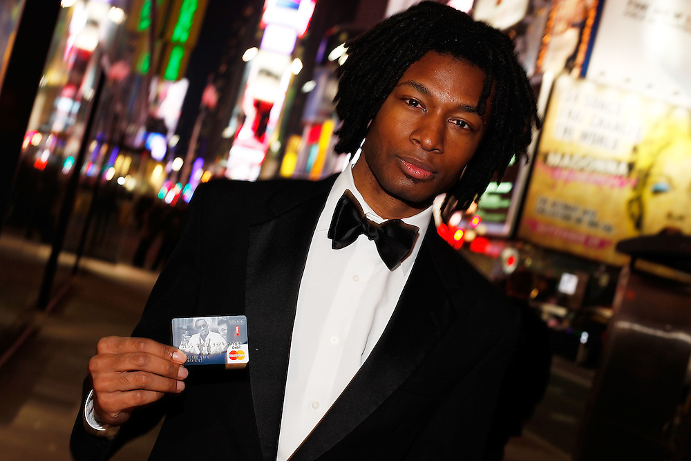 NEW YORK - DECEMBER 14:  A Ciroc street team member gives NYE Revelers Safe Rides Home at Times Square  on December 14, 2009 in New York City.  (Photo by Joe Kohen/Getty Images for Ciroc)