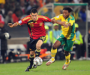 Sergio Busquets ans Macbeth Sabaya  during the soccer match of the 2009 Confederations Cup between Spain and South Africa played at the Freestate Stadium,Bloemfontein,South Africa on 20 June 2009.  Photo: Gerhard Steenkamp/Superimage Media.