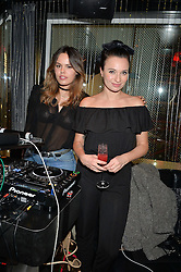 Left to right, ATLANTA de CADENET TAYLOR and GIZZI ERSKINE at Rock The Empire - a party hosted by Alexa Chung to celebrate the launch of W Beijing - Chang'an held at the Wyld Bar, W London, Leicester Square, London on 19th February 2015.