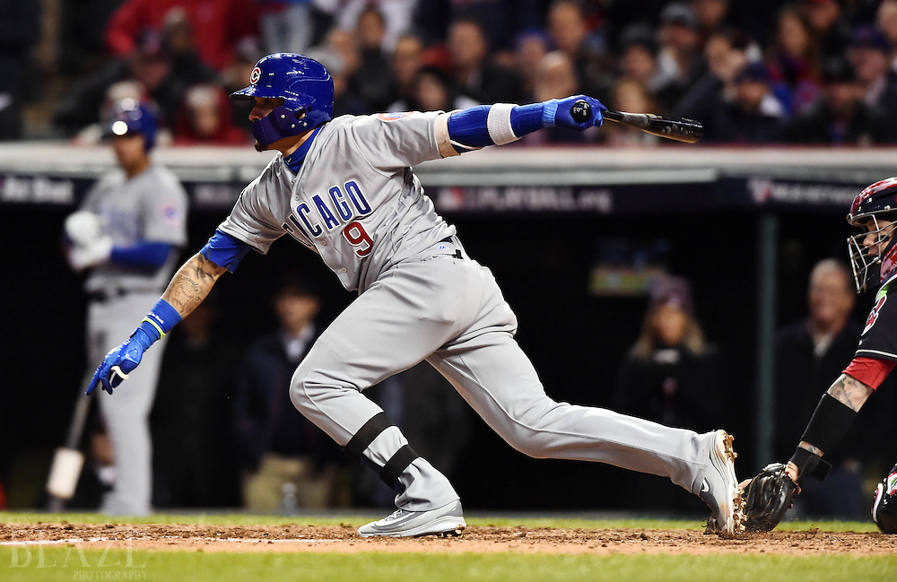 Oct 25, 2016; Cleveland, OH, USA; Chicago Cubs second baseman Javier Baez (9) hits a single against the Cleveland Indians in the 7th inning in game one of the 2016 World Series at Progressive Field. Mandatory Credit: Ken Blaze-USA TODAY Sports