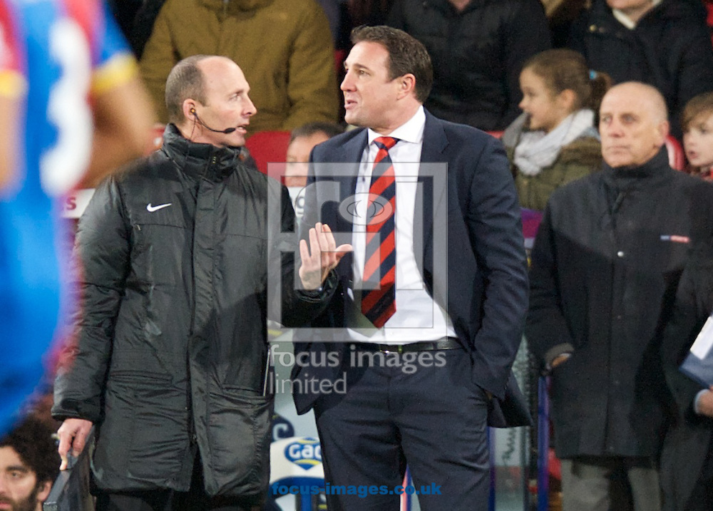 Picture by Alan Stanford/Focus Images Ltd +44 7915 056117<br /> 07/12/2013<br /> Manager Malky Mackay of Cardiff City speaks to official Mike Dean during the Barclays Premier League match at Selhurst Park, London.