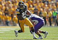 September 15 2012: Iowa Hawkeyes running back Damon Bullock (32) on a run during the first quarter of the NCAA football game between the Northern Iowa Panthers and the Iowa Hawkeyes at Kinnick Stadium in Iowa City, Iowa on Saturday September 15, 2012. Iowa defeated Northern Iowa 27-16.
