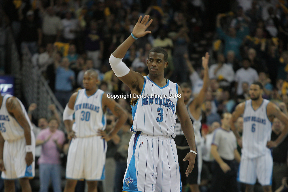 17 December 2008: New Orleans Hornets guard Chris Paul (3) waves to the crowd after setting an NBA record with his 106th consecutive game with a steal during a NBA regular season game between the Western Conference rivals the San Antonio Spurs and the New Orleans Hornets at the New Orleans Arena in New Orleans, LA..