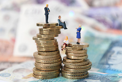 Models of men and women on a pile of coins and bank notes. A survey issued by NatWest has found nearly half of 18 to 24-year-olds say they fear more for the state of their finances in 2019 than they did last year.