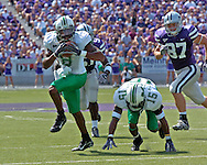 Marshall's James J.J. Johnson (8) picks up a blocked punt and rushes 18-yards for the tying touchdown in the second quarter, at Bill Snyder Family Stadium in Manhattan, Kansas, September 16, 2006.  The Wildcats beat the Thundering Herd 23-7.