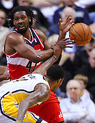 March 29, 2012; Indianapolis, IN, USA; Washington Wizards center Nene (42) has the ball stripped by Indiana Pacers shooting guard Paul George (24) at Bankers Life Fieldhouse. Indiana defeated Washington 93-89. Mandatory credit: Michael Hickey-US PRESSWIRE