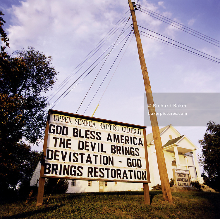 """Patriotic Americana - After 9/11. A Baptist church proclamation, Maryland USA. In the week after the September 11th attacks, America sought to express their anger and patriotic unity. A patriotic, Christian message is spelled outside a Baptist church in Cedar Grove, Maryland..""""That this nation under God shall have a new birth of freedom, and that government of the people, by the people, for the people shall not perish from the earth."""" - By Abraham Lincoln?s Gettysburg Address, November 19th, 1863."""