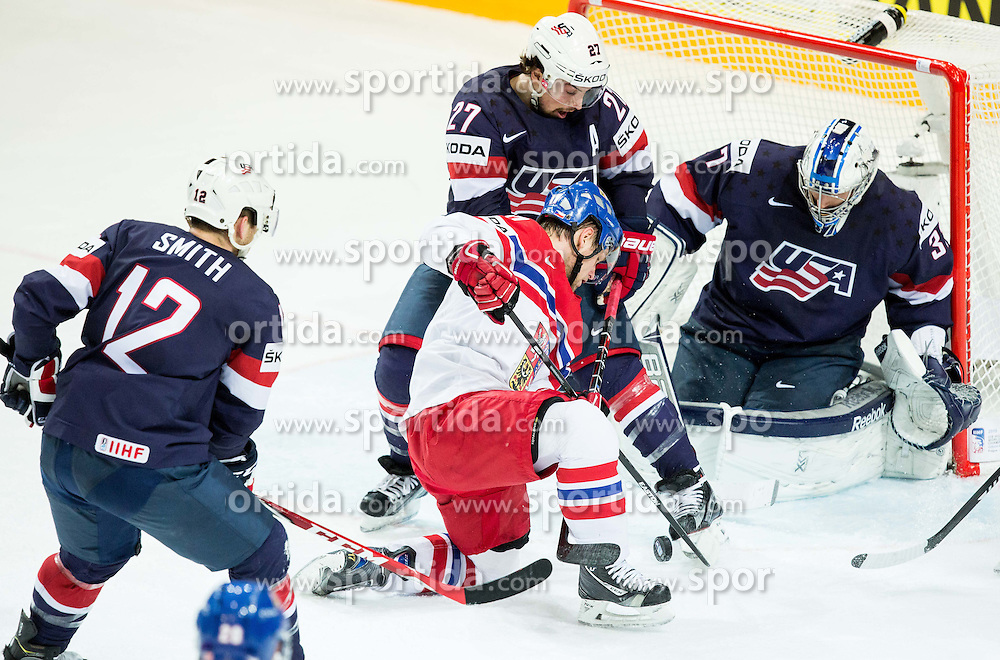 Vladimir Sobotka of Czech Republic vs Justin Faulk of USA and Connor Hellebuyck of USA during Ice Hockey match between USA and Czech Republic at Third place game of 2015 IIHF World Championship, on May 17, 2015 in O2 Arena, Prague, Czech Republic. Photo by Vid Ponikvar / Sportida