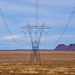 Power lines march toward the horizon and the Four Corners Power Plant in northwestern New Mexico near Shiprock on the Navajo Indian Reservation.