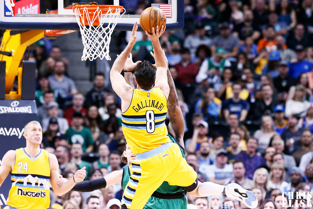 10 March 2017: Denver Nuggets forward Danilo Gallinari (8) takes a jump shot over Boston Celtics forward Jae Crowder (99) during the Denver Nuggets 119-99 victory over the Boston Celtics, at the Pepsi Center, Denver, Colorado, USA.