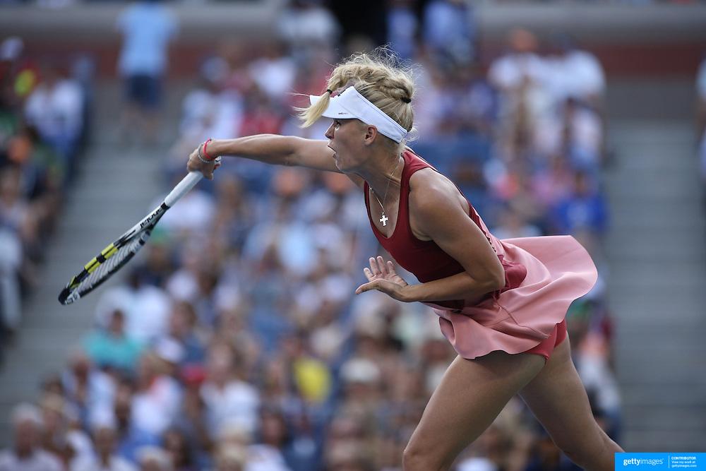 Caroline Wozniacki, Denmark,  in action against Serena Williams, USA,  in the  Women's Singles Final during the US Open Tennis Tournament, Flushing, New York, USA. 7th September 2014. Photo Tim Clayton