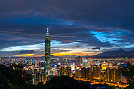 Sunset over Taipei 101 and the Taipei City skyline.