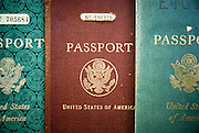 Three vintage American passports from the 1930s, 1940s and 1950s.