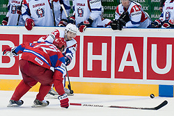Andrej Hebar of Slovenia vs Konstantin Korneyev of Russia during ice-hockey match between Russia and Slovenia of Group A of IIHF 2011 World Championship Slovakia, on May 1, 2011 in Orange Arena, Bratislava, Slovakia. (Photo by Matic Klansek Velej / Sportida)
