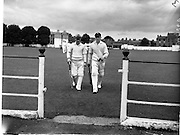 30/06/1959<br /> 06/30/1959<br /> 30 June 1959<br /> Schoolboy Interprovincial Cricket, Leinster v Ulster, Rathmines, Dublin. Leaving the field at the end of play are Ulster players J. Collins, (Campbell College) right, and W.S. Colton, (Foyle College).